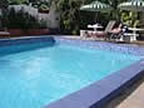 The pool available for the use of Bananaquit guests