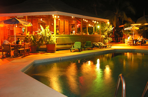 The restaurant and pool area at night